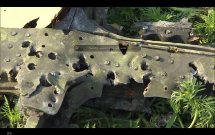 MH17 cockpit right window frame bullet holes